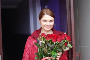 букет червоних троянд фото